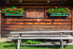 External facade of a typical alpine hut on the Incisa meadows, Dolomites, Corvara in Badia, Bolzano, South Tyrol, Itay