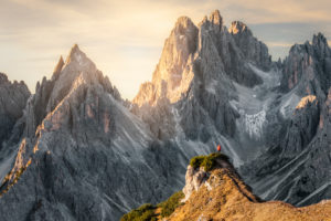 Hiker standing in front of the sharp peaks of Cadini di Misurina, Dolomites, Auronzo di Cadore, Belluno, Veneto, Italy