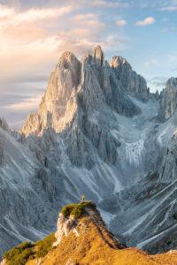 Hiker standing in front of the sharp peaks of Cadini di Misurina, Dolomites, Auronzo di Cadore, Belluno, Veneto, Italy