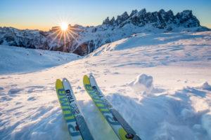 ski mountaineering boards with the tips facing the rising sun, dolomites, laresei refuge, pale di san martino, agordino, belluno, veneto, italy