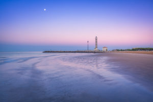 Jesolo, lighthouse beach at dawn, adriatic sea, venice, veneto, italy