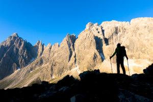 hiker in silhouette in the vallon popera, monte popera, comelico superiore, belluno, veneto, italy