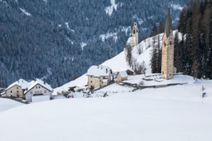 Alpine village of Tolpei with the St. Barbara chapel in winter, La Valle - Wengen, Val Badia, Bolzano, Dolomites, South Tyrol, Italy