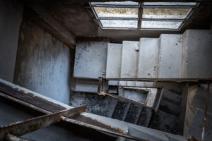 staircase in an old abandoned cement plant, industrial ruins, castellavazzo, belluno, veneto, italy