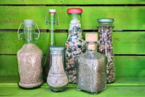 sea sand in glass bottles, souvenirs from summer holidays