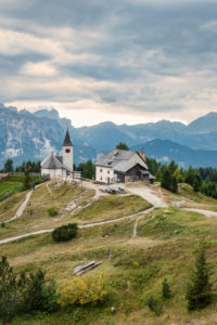 Heilig Kreuz Hospiz refuge and pilgrimage church at the foot of the Heiligkreuzkofel, in background Puez-Geisler Nature Park, Hochabtei / Alta Badia, Bolzano province, South Tyrol, Italy, Europe