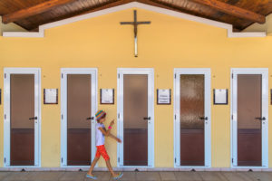 little girl in front of the doors of the multilingual confessionals, Medjugorje,  municipality of Citluk, Bosnia and Herzegovina,