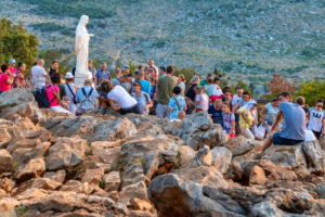 pilgrims on the hill of apparitions, Podbrdo, Medjugorje, municipality of Citluk, Bosnia and Herzegovina,