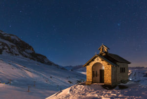 Europe, Italy, Dolomites. The alpine church at Pordoi pass at night