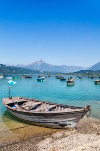 fishermen boats anchored to the poiatte, lake of santa croce, farra d'Apago, alpago, belluno, veneto, italy