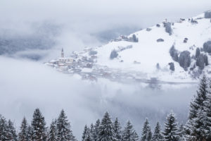 the villages of candid and casamazzagno emerging from the winter mists, dolomites, comelico superiore, belluno, veneto, italy, europe