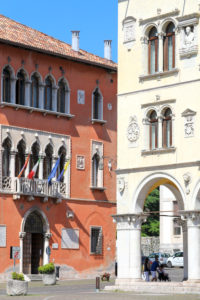 Italy, Veneto, Belluno, Dolomites, the facade of Palazzo Rosso seat of the town hall of Belluno and the yellow facade of Palazzo dei Rettori seat of the Prefecture