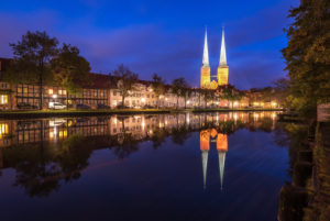 During the blue hour in the Obertrave with view to the Lübeck cathedral