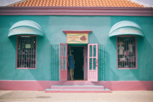 turquoise and pink shop in old house on bonaire island