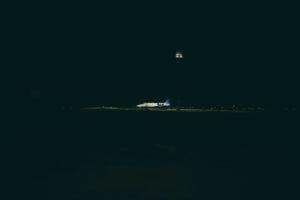airplane at night on bonaire flamingo airport