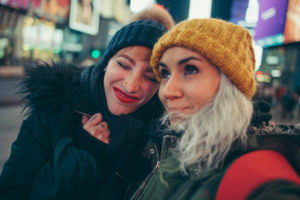 Two girlfriends on times square new york