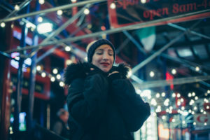blonde short hair girl on times square on a winter night