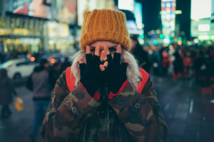 White hair girl with yellow winter hat on times square new york