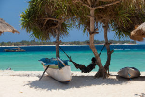 Indonesia, Lombok, Gili Meno, man in his hammock