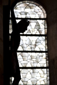 Silhouette of a cross in the Speyer Cathedral