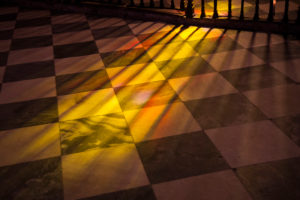 Beautiful colorful sunlight window reflections on the floor of a church, Andalusia, Spain, Carmona, Iglesia Prioral de Santa Maria