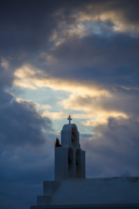 cloud movements with evening light in front of the cross of a chapel, Thira, Greece, Santorini, Santorini