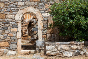 View on archway of a ruined house on Spinalonga, former leprosy island, Greece, Crete, Kalydon