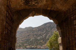 View through the entrance gate from Spinalonga, (former leprosy island) to the Cretan mainland, Greece, Crete, Kalydon