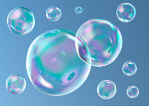 Soap bubbles against a blue background gradient without ambient reflections