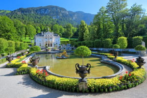 Basin with golden sculpture group in the garden ground floor in front of castle Linderhof, parish of Ettal, Ammertal, Ammergauer alps, Upper Bavaria, Bavaria, Germany