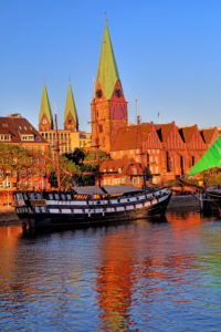 Historic sailing ship on the banks of the Weser river in front of the old town with Martini church and cathedral towers, Bremen, Land Bremen, Northern Germany, Germany