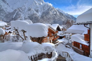 Snow covered houses against Karwendel mountains, Mittenwald, Werdenfelser Land, Upper Bavaria, Bavaria, Germany