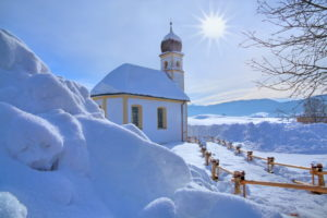 Winter landscape with St. Leonhard church, Hundham, Leitzach valley, Upper Bavaria, Bavaria, Germany