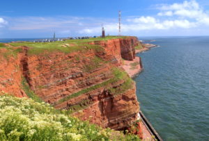 Northwest cliff with lighthouse and transmission tower on the Oberland, Heligoland, Heligoland Bay, German Bight, North Sea island, North Sea, Schleswig-Holstein, Germany