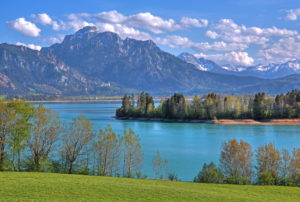Spring landscape at Forggensee against Säuling (2047m) of the Ammergau Alps, Halblech, Romantic Road, Ostallgäu, Allgäu, Swabia, Bavaria, Germany