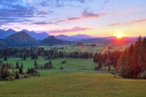 Spring landscape against Tannheim mountains at sunset, Hohenschwangau, Romantic Road, Ostallgäu, Allgäu, Swabia, Bavaria, Germany