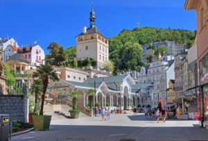Market square with market colonnade and castle in the spa area, Karlsbad, spa triangle, Bohemia, Czech Republic