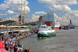 Harbor tourboat in front of the St. Pauli landing stages, museum ship 'Cap San Diego' and Elbphilharmonie, Hamburg, Hamburg State, Germany