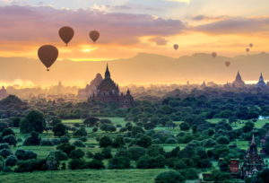 Hot air balloons over the ruin field with stupas and Sulamanite temple in the 'Plain of 2000 Pagodas', Bagan Historical Royal City, Myanmar, Sunset