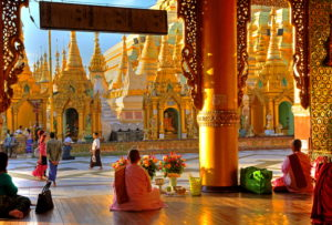 Meditating nuns in front of the Shwedagon Pagoda, Yangon, Myanmar