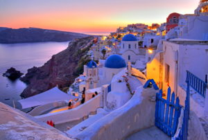 Village view with churches on the hillside above the caldera, Ia, (Oia), Santorin, (Thira), Cyclades, Aegean Islands, Aegean, Greece, dusk