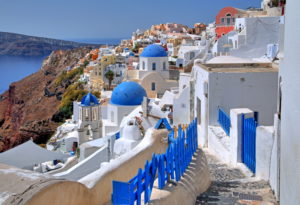 Village view with churches on the hillside above the caldera, Ia, (Oia), Santorin, (Thira), Cyclades, Aegean Islands, Aegean Sea, Greece
