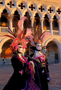 Fantasy masks in front of the Doge's Palace during Carnival, Venice, Veneto, Italy