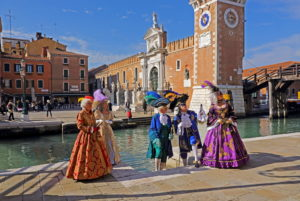 Costumed group in historical robes at the Arsenale during Carnival, Venice, Veneto, Italy