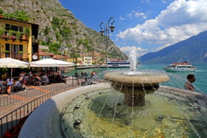 Restaurant terrace on the lakeshore with fountain, Limone sul Garda, Lake Garda, Lombardy, Northern Italy, Italy