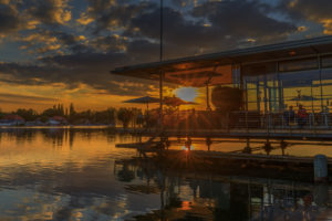 Hannover, Maschsee, sailing school and pier 51 in the sundown