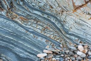 Kieselsteine und Felsenstruktur an der Costa Verde, Spanien, Playa del Silencio, Asturien, Nord Spanien,