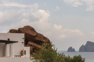 Sicily - Sunny impressions of the Aeolian Islands, also known as Aeolian Islands or Isole Eolie: Lipari, Stromboli, Salina, Vulcano, Panarea, Filicudi and Alicudi. White house built in a rock face, Panarea.