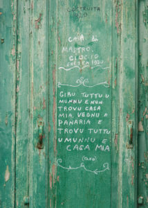 "Sicily - Sunny impressions of the Aeolian Islands, also known as the Aeolian Islands or Isole Eolie. Lettering on a door in Panarea: ""I travel the whole world and cannot find a home, I come to Panarea and find the whole world and my home""."