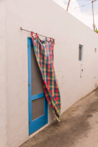 Sicily - Sunny impressions of the Aeolian Islands, also known as Aeolian Islands or Isole Eolie: Lipari, Stromboli, Salina, Vulcano, Panarea, Filicudi and Alicudi. Typical door curtain on Panarea.